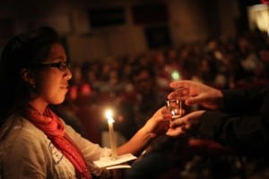 Passing the Light at IFTJ / Image: Ignatian Solidarity Network